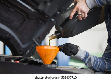 A technician in the workshop exchanges oil