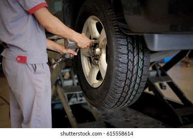 Technicians are changing car tires.