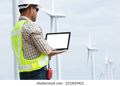 Technicians engaged of a wind turbine installation for the production of energy.