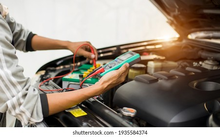 Technicians inspect the car's electrical system.
