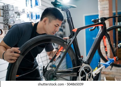 Technicians are repairing bicycles at shop sells