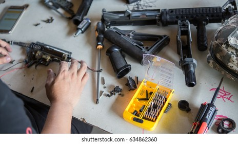 Technicians are repairing guns