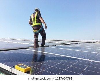 Technicians are testing the value of solar energy.