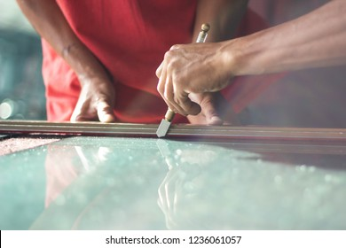 Technicians are using cutting tools, cut glass according to customer size