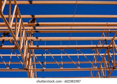 Technicians are welding steel structure roof. Construction site