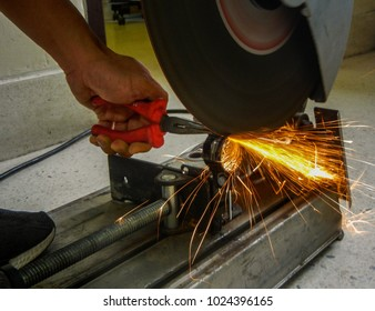 Technicians were cutting metal parts to assembly machines with electric cutting matal