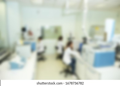 technicians working in biotechnology laboratory with blur effect