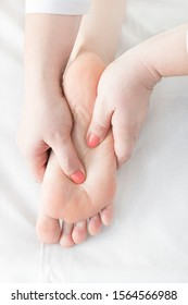 Technique of sports and wellness foot massage. Close-up shot in a beauty salon.