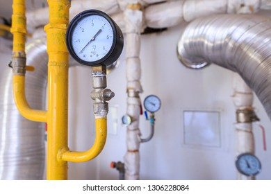 Technological equipment of small gas boiler house. Pipes for gas and for water. Various temperature and pressure sensors.