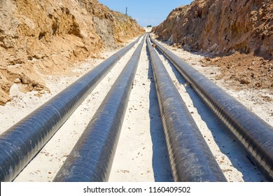Technological pipelines DN50 and DN 150 make a turn by means of bends in the trench and approach the well