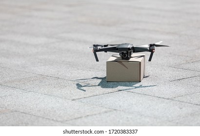 Technological shipment innovation drone fast delivery concept, drone with cardboard parcel