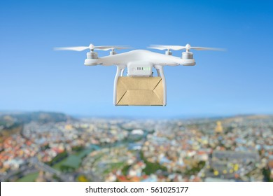 Technological shipment innovation - drone fast delivery concept, multicopter flying with cardboard box above city