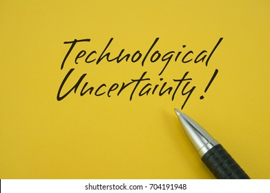 Technological Uncertainty! note with pen on yellow background