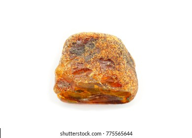 Technology of amber mining. A beautiful large unprocessed piece of amber in its natural form with a crust on a white background. Amber as an ancient fossil mineral. Fossil resin for jewelry. Sunstone