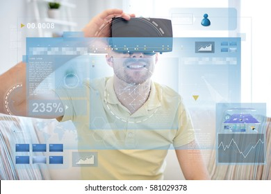 technology, augmented reality, big data and people concept - happy young man with virtual headset or 3d glasses looking at screens projection
