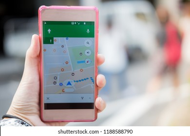 technology background, hand of caucasian woman holding mobile phone with gps map on screen