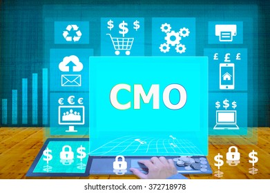 technology and biz concept. working on his laptop in the secured office, select icon CMO or  Chief Marketing Officer  on the virtual display
