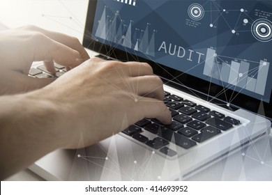 technology and business concept: man using a laptop with audit software on the screen. All screen graphics are made up.