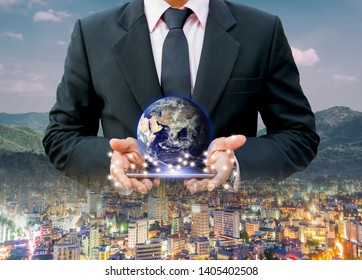 Technology city Network communication network system business Earth on hand world of Elements of this image furnished by NASA.