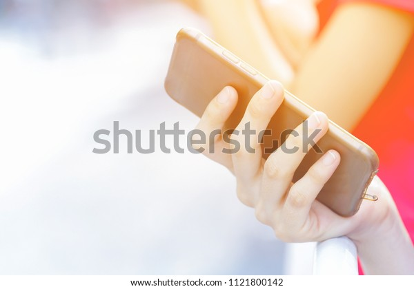 Technology and communication concept. Cropped shot of a woman's hand holding mobile phone