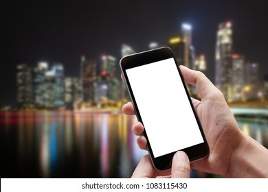 Technology, Communication and People concept - close up of man hands with smartphone texting message on city street blurred background. blank screen for graphics display montage.
