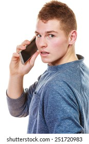 Technology and communication. Young man casual style talking on mobile cell phone using smartphone isolated on white
