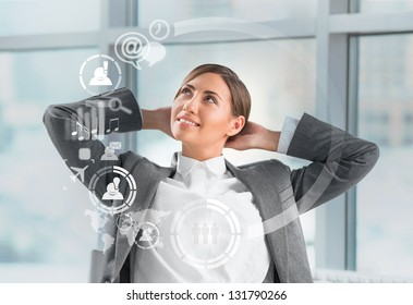 Technology concept. Businesswoman and virtual interface with web and social media icons