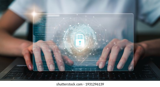 Technology concept with cyber security internet and networking, Businessman hand working on laptop, screen padlock icon on digital display. - Shutterstock ID 1931296139