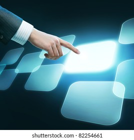 Technology concept. Man's hand pushing the button