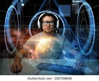 technology, cyberspace, programming and people concept - hacker man in headset and eyeglasses with pc computer keyboard over virtual projections