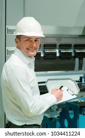 Technology Engineer Working in Factory. Holding check-list and supervising
