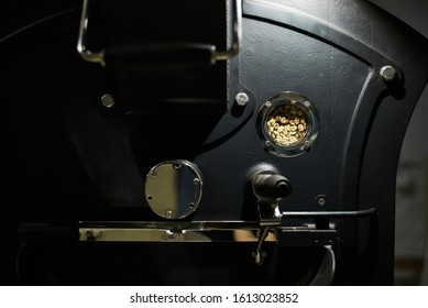 Technology and equipment for processing coffee. Modern professional equipment for roasting coffee. Close-up.