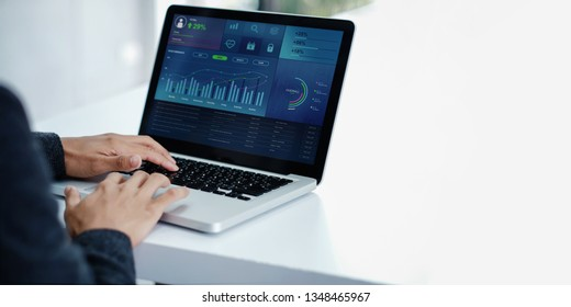 Technology in Finance and Business Marketing Concept. Graphs and Charts show on Computer's Screen. Modern Businessman seeing Statistical Data on Laptop in Office