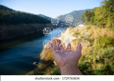 Technology, hand holding with environment Icons over the Network connection on green background.