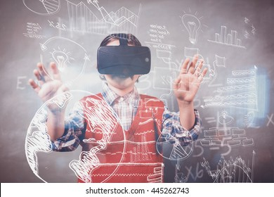 Technology icons against boy using a virtual reality device