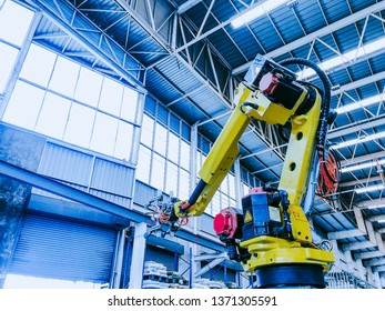 technology and industry 4.0 revolution  concept from high precision robotic system control set up at top of injection machine