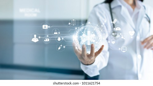 Technology Innovation and medicine concept. Doctor and medical network connection with modern virtual screen interfacein in hand on hospital background