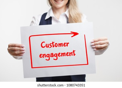 Technology internet business and marketing. Young business woman writing word: Customer engagement