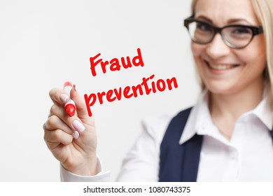 Technology internet business and marketing. Young business woman writing word: fraud prevention