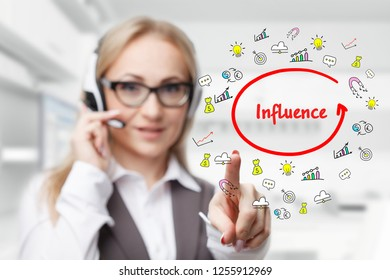 Technology, internet, business and marketing. Young business woman writing word: Influence