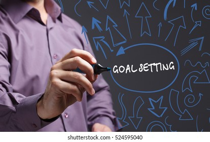 Technology, internet, business and marketing. Young business man writing word: goal setting
