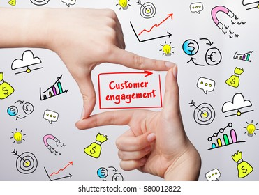 Technology, internet, business and marketing. Young business woman writing word: Customer engagement