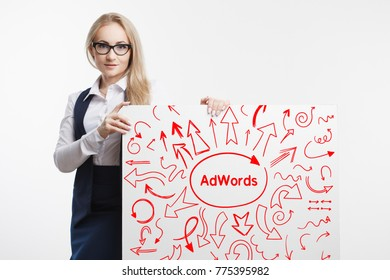 Technology, internet, business and marketing. Young business woman writing word: AdWords