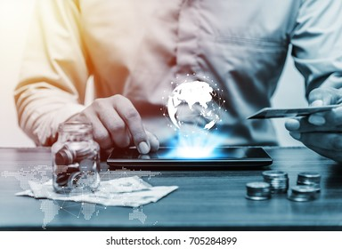 Technology network and online banking and internet banking and networking people concept, Business man with laptop and credit card with coin money on business office table