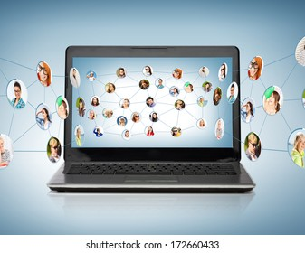 technology, networking and communication concept - laptop computer with social network on screen