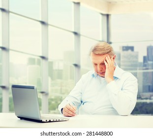 technology, oldness and people concept - senior man with laptop and pen writing over office window background
