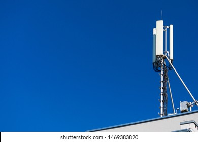 Technology on the top of the telecommunication GSM. Masts for mobile phone signal. Tower with antennas of cellular communication on the background of blue sky. Copy space on left side