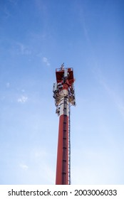 Technology on the top of the telecommunication GSM 5G,4G,3G tower.Cellular phone antennas on a building roof.Telecommunication mast television antennas.Receiving and transmitting stations