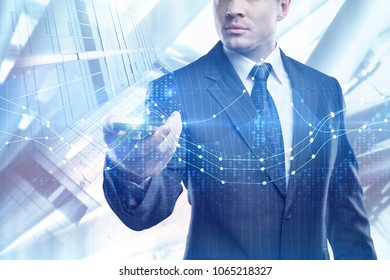 Technology, online analysis, finance and management concept. Businessman using smartphone with glowing forex chart on abstract city background. Double exposure