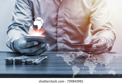 Technology people global network concept, Business man with smart phone and earth and world map virtual on office table